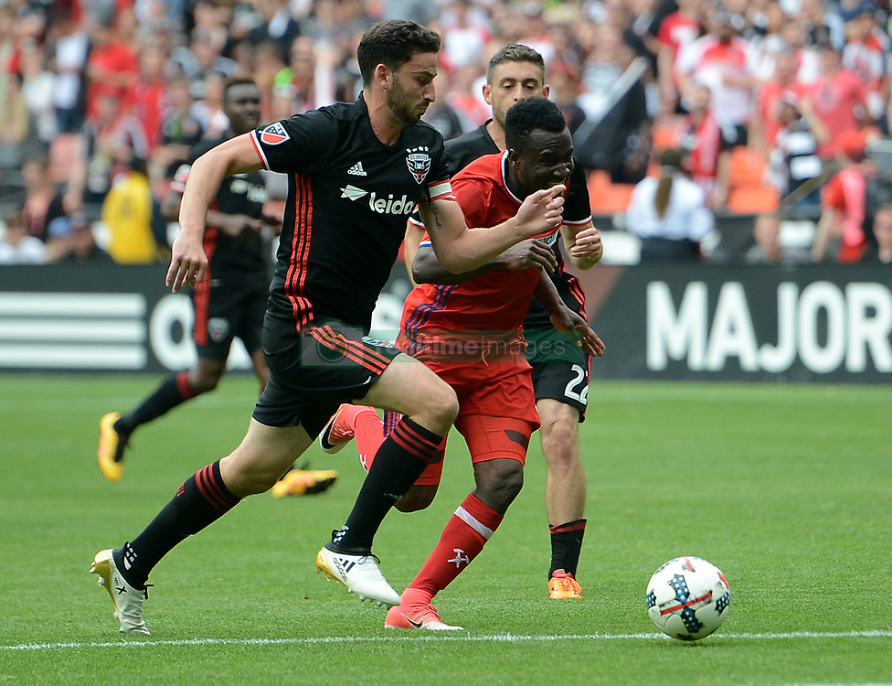 May 20, 2017 - Washington, DC, USA - 20170520 - Chicago Fire midfielder DAVID ACCAM (11) attempts to break between D.C. United defender STEVE BIRNBAUM (15), left, and D.C. United defender CHRIS KORB (22) in the first half at RFK Stadium in Washington. (Credit Image: © Chuck Myers via ZUMA Wire)