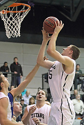 16 November 2013:  Nick Anderson offers a short jump shot during an NCAA mens division 3 basketball game between the Aurora University Spartans and the Illinois Wesleyan Titans in Shirk Center, Bloomington IL