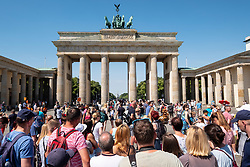 Many tourists in front of Brandenburg Gate in Berlin, Germany