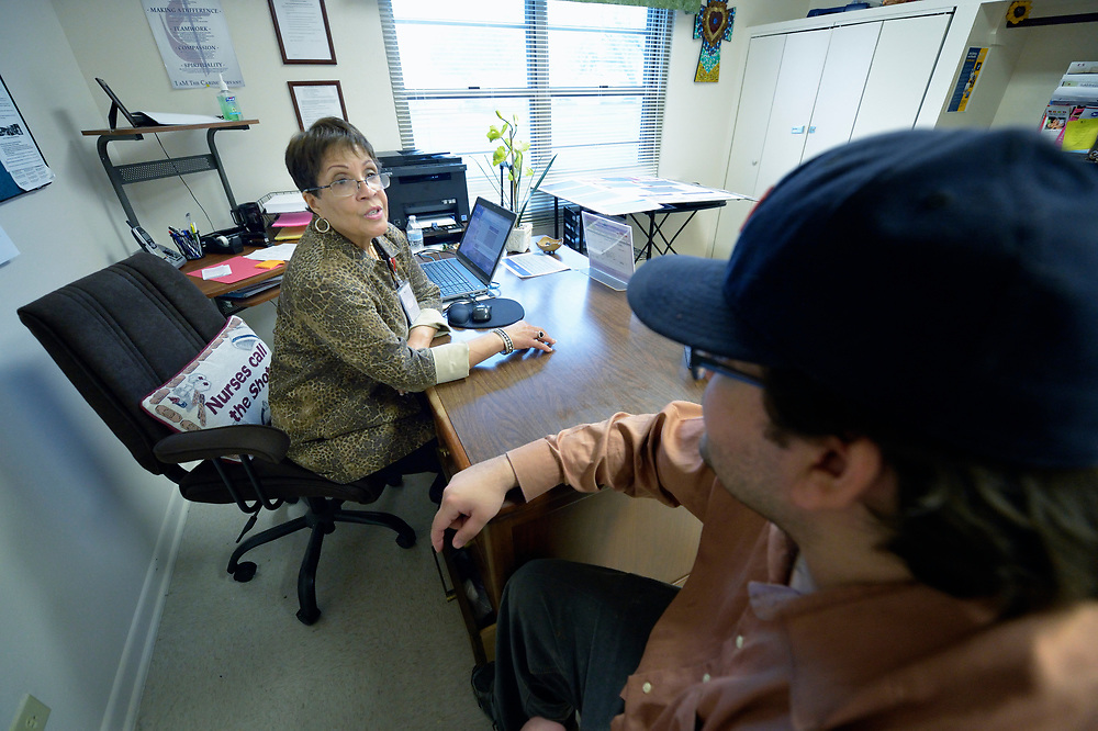 Enomie Rosenthal, a faith community nurse at Bethany United Methodist Church in San Antonio, Texas, talks with a client in her office.