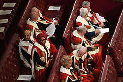 Peers find their places ahead of the State Opening of Parliament by Queen Elizabeth II, in the House of Lords at the Palace of Westminster in London.