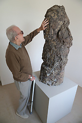 Man with visual impairment touching a sculpture at Yorkshire Sculpture Park.