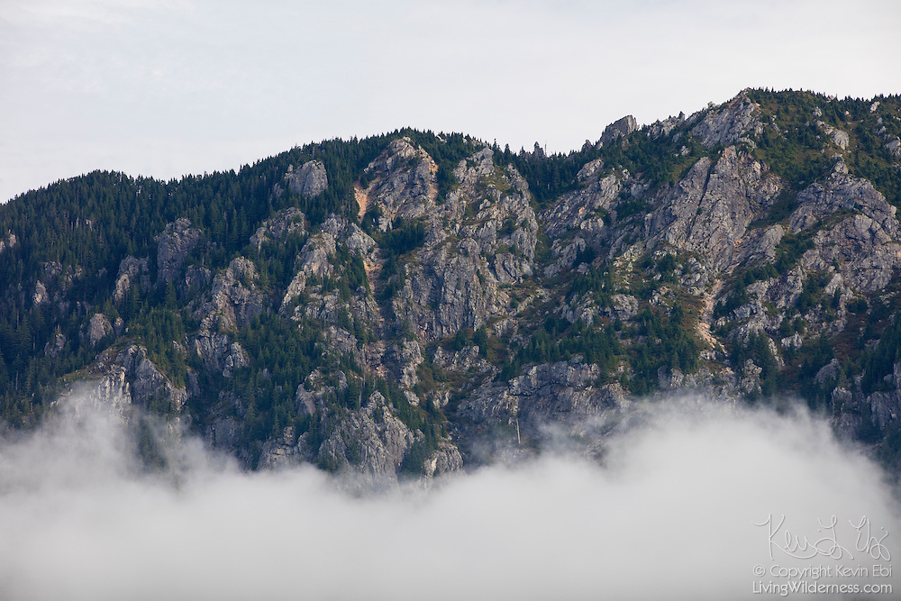 Bald Mountain, a 4520-foot (1378-meter) peak in the Sultan Basin of Snohomish County, Washington, rises over a fog bank sitting over Spada Lake.