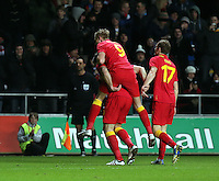 Pictured: Samuel Vokes of Wales celebrating his goal with team mate Jack Collison (9) and Andrew King (17) while Austria players stand dejected. Wednesday 06 February 2013..Re: Vauxhall International Friendly, Wales v Austria at the Liberty Stadium, Swansea, south Wales.