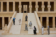 "Local guides and caretakers on the steps at the ancient Egyptian Temple of Hatshepsut near the Valley of the Kings, Luxor, Nile Valley, Egypt. The Mortuary Temple of Queen Hatshepsut, the Djeser-Djeseru, is located beneath cliffs at Deir el Bahari (""the Northern Monastery""). The mortuary temple is dedicated to the sun god Amon-Ra and is considered one of the ""incomparable monuments of ancient Egypt."" The temple was the site of the massacre of 62 people, mostly tourists, by Islamists on 17 November 1997."