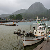 Tsuma, a fishing village near Mt. Takada,  is known for its traditional boat houses (Tsuma Funa-goya) which line the water's edge. Tsuma is located on Dogo, the largest island of the Oki Islands which is an archipelago in the Sea of Japan, Shimane Prefecture, Japan.