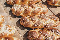 THEMENBILD - am Karfreitag bäckt die Bäckerei Gugglberger zum ersten Mal im Jahr Bauernbrot und Milchbrot bzw. Osterstriezel, im alten, traditionellen Holzofen neben dem Meixnerhaus am Kirchbichl oberhalb von Kaprun. Gold braun gebackener Osterstriezel auf einem Holzbrett, aufgenommen am 10. April 2020 in Kaprun, Oesterreich // on Good Friday the bakery Gugglberger bakes farmhouse bread and milk bread or Osterstriezel for the first time in the year, in the old, traditional wood oven next to the Meixnerhaus at the Kirchbichl above Kaprun. Gold brown baked Easter ostrich on a wooden board, in Kaprun, Austria on 2020/04/10. EXPA Pictures © 2020, PhotoCredit: EXPA/Stefanie Oberhauser