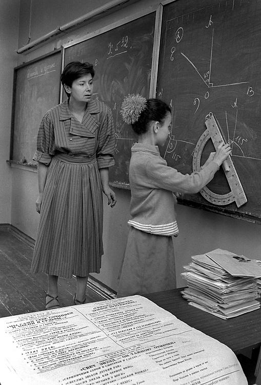 Pupil and teacher. Maths class.<br /> Admiraltiskii Rayon Area<br /> School number 235<br /> St Petersburg, Russia 1994