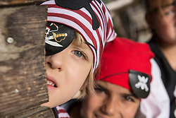 Children dressed up as pirates playing in a playground, Bavaria, Germany