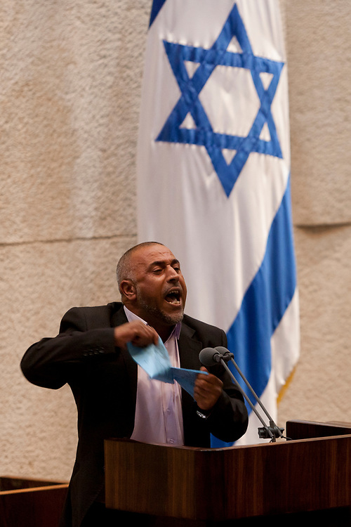 Bedouin-Israeli lawmaker, Member of the Knesset Taleb Abu Arar of the Ra'am-Ta'al party (acronym for United Arab List and Arab Movement for Renewal in Hebrew) tears the 'Praver Bill' in protest, during a debate on the bill, which is aimed at Bedouin settlements regularization in the Negev, at the Knesset, Israel's parliament in Jerusalem, on June 24, 2013. Arab-Israeli Knesset members tore the bill on the parliament's podium in protest of the proposed Bill which narrowly passed first reading.