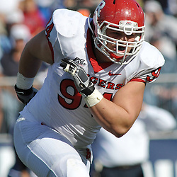 Oct 31, 2009; East Hartford, CT, USA; Rutgers defensive tackle Scott Vallone (94) chases down the play during first half Big East NCAA football action between Rutgers and Connecticut at Rentschler Field.