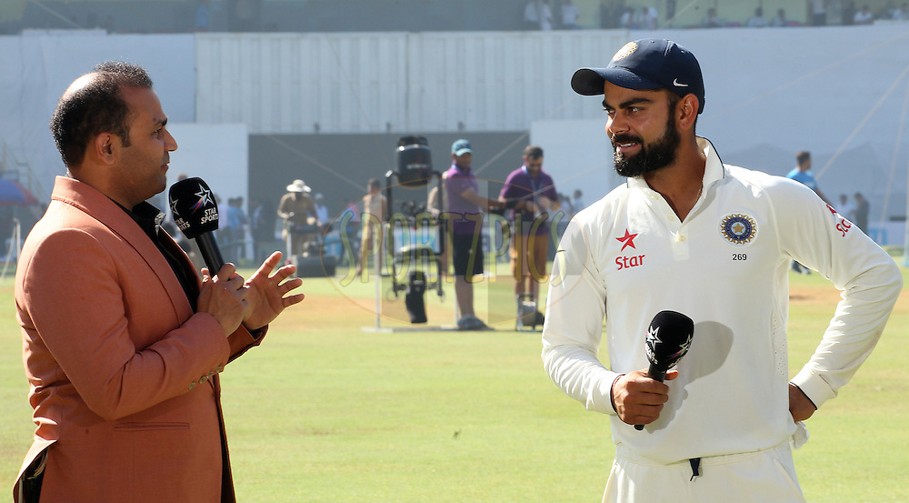 Virender Sehwag and Virat Kohli Captain of India chat after the match during day 5 of the fourth test match between India and England held at the Wankhede Stadium, Mumbai on the 12th December 2016.<br /> <br /> Photo by: Ron Gaunt/ BCCI/ SPORTZPICS