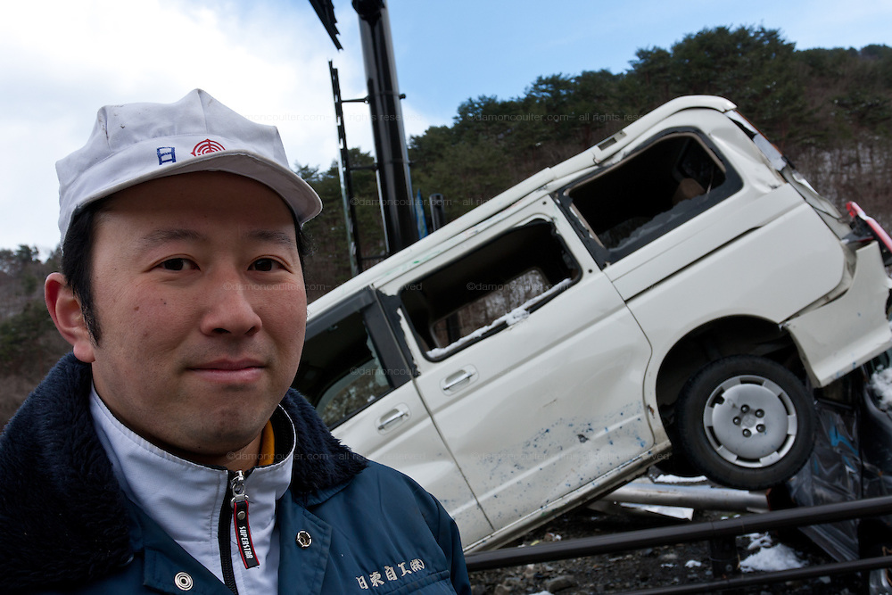 Mechanic, Toshifumi Kikuchi in the remains of his garage and car business after the tsunami in Kamaishi, Iwate, Japan. March 17th 2011