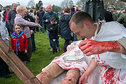 Crowds at Morley watch the Infantry Regiment 276, field Hospital Display as a surgeon operates on a battlefield casualty <br /> 24 April 2016<br /> Copyright Paul David Drabble<br /> www.pauldaviddrabble.photoshelter.com