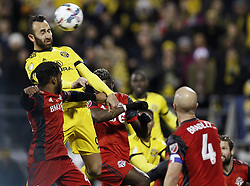 November 21, 2017 - Columbus, OH, USA - Columbus Crew forward Justin Meram (9) goes up for a header that hit the cross bar against Toronto FC in the second half of the first leg of the MLS Eastern Conference finals at MAPFRE Stadium in Columbus, Ohio, on Tuesday, Nov. 21, 2017. After a scoreless draw, the teams move to Toronto for the final leg on November 29. (Credit Image: © Kyle Robertson/TNS via ZUMA Wire)