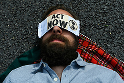 © Licensed to London News Pictures. 01/09/2020. LONDON, UK.  A (sleeping) activist from Extinction Rebellion takes part in a climate change protest in Parliament Square on the day that Members of Parliament return to Westminster after the summer recess.  Photo credit: Stephen Chung/LNP
