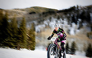 SHOT 2/8/13 4:01:41 PM - Rebecca Gross (#305) of Lakewood, Co. competes in the 20K X-Country On-Snow Mountain Bike Race at the second annual Winter Mountain Games presented by Eddie Bauer at Vail Ski Resort in Vail, Co. Gross finished first in the Open Women's Class with a time of 1:06:09. The Winter Mountain Games feature competitions in X-Country On-Snow Mountain Bike Races, mixed climbing, Telemark Big Air,Best Trick Bike and On-Snow Mountain Bike Crit with more than $60,000 in prize money on the line. (Photo by Marc Piscotty / © 2013)
