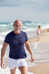 man enjoying a walk on the beach in Florida