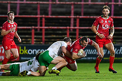 11th November 2018 , Racecourse Ground,  Wrexham, Wales ;  Rugby League World Cup Qualifier,Wales v Ireland ; Steve Parry of Wales is tackled by Tyrone McCarthy of Ireland <br /> <br /> <br /> Credit:   Craig Thomas/Replay Images