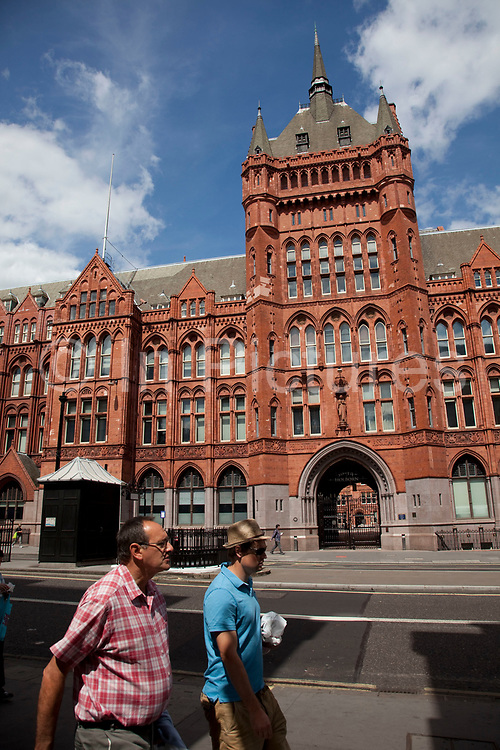 Beautiful red brick architecture of the Prudential Assurance building on High Holborn in Central London. The building's name is Holborn Bars, built as the headquarters of the Prudential Assurance Company.