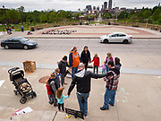 "18 MAY 2020 - DES MOINES, IOWA: People in a prayer circle during an anti-vaccine prayer vigil. About eight adults, and their children, gathered in the front of the Iowa State Capitol in Des Moines Monday for a prayer vigil against mandatory vaccines. Iowa state law allows the governor to mandate vaccines for communicable diseases during a public health emergency and the ""anti-vaxxers"" are afraid the government will mandate a vaccine for Coronavirus (SAR-CoV-2) if one is developed. As of May 18, 355 people in Iowa have died from COVID-19, the disease caused by the Coronavirus (SARS-CoV-2), and 14,955 have tested positive for the Coronavirus.               PHOTO BY JACK KURTZ"