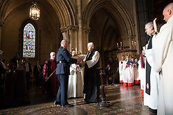 Assistant Garda Commissioner Patrick Leahy presenting the heart of Laurence OÕToole to Archbishop of Dublin, Most Revd Dr Michael Jackson at Christ Church Cathedral in Dublin, after the relic that has been missing for six years has been recovered undamaged.
