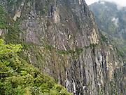 The trail that traverses the side of Montaña Machu Picchu before arriving at the Inca Drawbridge and a back entrance to Machu Picchu. Aguas Calientes, Peru