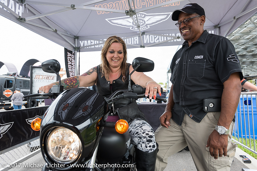 Michele Kinner of Montague, NJ, gets instructions from Harley-Davidson Riding Academy instructor Terry Siler on the Jump Start Experience at the Harley-Davidson display at the Daytona Speedway during Daytona Bike Week. Daytona Beach, FL. USA. Monday March 13, 2017. Photography ©2017 Michael Lichter.