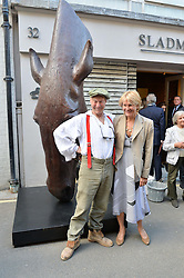 NIC FIDDIAN GREEN and his wife HENRIETTA at a private view of work & workings of Nic Fiddian Green - The Studio held at Sladmore Contemporary, 32 Bruton Place, London on 9th June 2015.