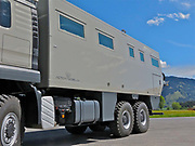 Amazing supersized motor home<br /><br />Painted in military green, weighing in at 18-tonnes and fitted with a giant set of wheels, this supersized camper van would not look out of place in a warzone.<br /><br />The massive vehicle, produced in Saalfelden am Steinernen Meer, Austria, has a 720-horsepower engine and comes with a 730,000 Euros price tag.<br /><br />But despite its tank-like appearance, the Action Mobil GLOBECRUISER FAMILY 7500 -described as a 'motor home for global cruises' - is also built for comfort and comes with 23 sq ft of living space, satellite TV, a washer and dryer, and a lift at the back to carry a motorbike.   <br />©Action Mobil/Exclusivepix Media