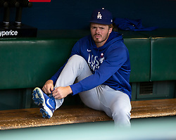 Oct 7, 2021; San Francisco, CA, USA; Los Angeles Dodgers infielder Gavin Lux (9) adjusts his equipment in the dugout during NLDS workouts. Mandatory Credit: D. Ross Cameron-USA TODAY Sports