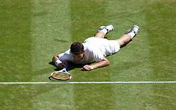 04.07.2014, All England Lawn Tennis Club, London, ENG, ATP Tour, Wimbledon, im Bild Grigor Dimitrov (BUL) falls over during the Gentlemen's Singles Semi-Final match on day eleven // during the Wimbledon Championships at the All England Lawn Tennis Club in London, Great Britain on 2014/07/04. EXPA Pictures © 2014, PhotoCredit: EXPA/ Propagandaphoto/ David Rawcliffe<br /> <br /> *****ATTENTION - OUT of ENG, GBR*****