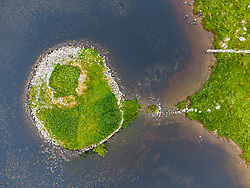 Aerial view from drone of ruin of Altabrug broch on small island on South Uist, Outer Hebrides, Scotland, UK
