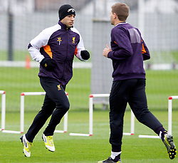 LIVERPOOL, ENGLAND - Wednesday, November 7, 2012: Liverpool's Luis Alberto Suarez Diaz and captain Steven Gerrard MBE during a training session at the club's Melwood Training Ground ahead of the UEFA Europa League Group A match against FC Anji Makhachkala. (Pic by Vegard Grott/Propaganda)