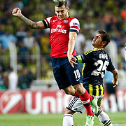 Fenerbahce's Emre Belozoglu (R) and Arsenal's Jack Wilshere (L) during the UEFA Champions League Play-Offs First leg soccer match Fenerbahce between Arsenal at Sukru Saracaoglu stadium in Istanbul Turkey on Wednesday 21 August 2013. Photo by /TURKPIX