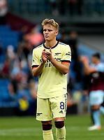 Football - 2021 / 2022 Premier League - Burnley vs. Arsenal<br /> <br /> Goalscorer Martin Odegaard celebrates his team's 1-0 win after the final whistle, at Turf Moor.<br /> <br /> <br /> COLORSPORT/ALAN MARTIN