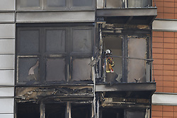 © Licensed to London News Pictures. 07/05/2021. London, UK. Fire fighters is inspect the charred remains of  apartments at New Providence Wharf on Fairmont Avenue in Poplar in east London. 100 fire fighters and 20 crews tackled the blaze at it's peak. Photo credit: Peter Macdiarmid/LNP
