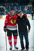 KELOWNA, BC - FEBRUARY 8: Cross Hanas #71 of the Portland Winterhawks and his father stand on the ice after warm up against the Kelowna Rockets at Prospera Place on February 8, 2020 in Kelowna, Canada. (Photo by Marissa Baecker/Shoot the Breeze)