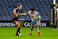 Rugby Union - 2020 / 2021 Guinness Pro-14 - Edinburgh vs Glasgow Warriors - Murrayfield<br /> <br /> Sam Johnson of Glasgow Warriors is tackled by Jaco van der Walt of Edinburgh Rugby<br /> <br /> COLORSPORT/BRUCE WHITE