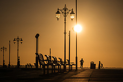 © Licensed to London News Pictures. 12/09/2017. Southsea, UK.  The silhouette of a woman jogging along Southsea Promenade shortly after sunrise this morning, 12th September 2017. Photo credit: Rob Arnold/LNP