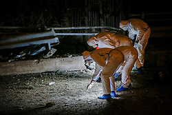 December 17, 2018 - Athens, Greece - Police forensic teams search for evidence after a bomb exploded outside Greece's SKAI TV building. There were no injuries or victims as an anonymous phone-call alerted authorities of the threat. (Credit Image: © Eurokinissi via ZUMA Wire)