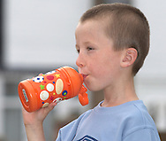 Young Boy Drinking from Plastic Bottle, Model Released