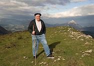 Monk shepherd Nikolas Segurola walks around the lands of Arantzazu's monastery in the Basque Country on November 16th, 2009. Nikolas Segurola has been a shepherds teacher for years at the Shepherds School of Arantzazu. (Ander Gillenea / Bostok Photo)