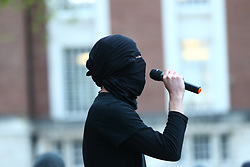 © Licensed to London News Pictures. 10/05/2021. Manchester, UK. A masked protester gives a speech at the University of Manchester's Samuel Alexander Building on Oxford Road.<br /> Students have occupied the building in protest at the leadership of Professor Dame Nancy Rothwell, the charging of full rent and tuition fees during the pandemic and police patrols on campus. Photo credit: Adam Vaughan/LNP