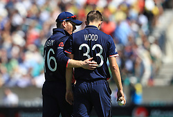 England captain Eoin Morgan speaks with Mark Wood during the ICC Champions Trophy, Group A match at The Oval, London.