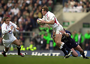 Twickenham, Surrey, 22nd March 2003,  RFU Twickenham Stadium, England, [Mandatory Credit; Peter Spurrier/Intersport Images]<br /> <br /> RBS Six Nations Rugby England v Scotland<br /> Mike Tindall releases the ball as Jonny Wilkinson run's on.