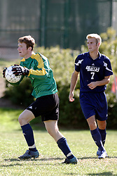 01 October 2006: Crusaders goalie returns the ball to play. The game remained scoreless until the 2nd overtime in which University of Dallas Crusaders Adam Lunger scored the Golden Goal to beat the Illinois Wesleyan Titans.  This game was played at Neis Field on the campus of Illinois Wesleyan University in Bloomington Illinois.
