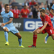 Stevan Jovetic, (left), Manchester City, challenged by Steven Gerrard , Liverpool, during the Manchester City Vs Liverpool FC Guinness International Champions Cup match at Yankee Stadium, The Bronx, New York, USA. 30th July 2014. Photo Tim Clayton