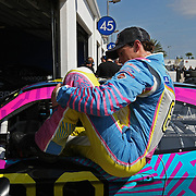 Rousch-Fenway Racing Ford driver Travis Pastrana exits his car in the garage area, during a NASCAR Drive4COPD Nationwide Series practice session at Daytona International Speedway on Thursday, February 21, 2013 in Daytona Beach, Florida.  (AP Photo/Alex Menendez)