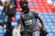 Wilfried Zaha of Crystal Palace wrapped up from the cold during prematch warm up.  Premier League match, Crystal Palace v Newcastle Uutd at Selhurst Park in London on Sunday 4th February 2018. pic by Steffan Bowen, Andrew Orchard sports photography.